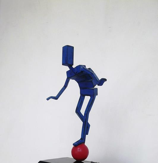 Balancing Act (mini-rolling blue man)